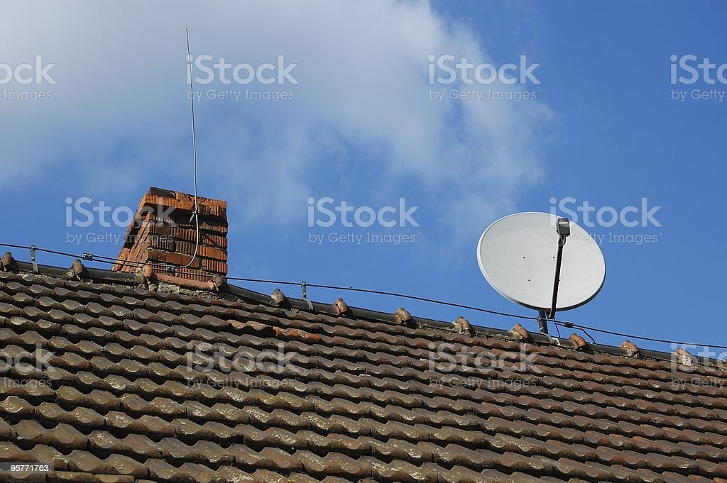 Satellite dish on an old house royalty-free stock photo