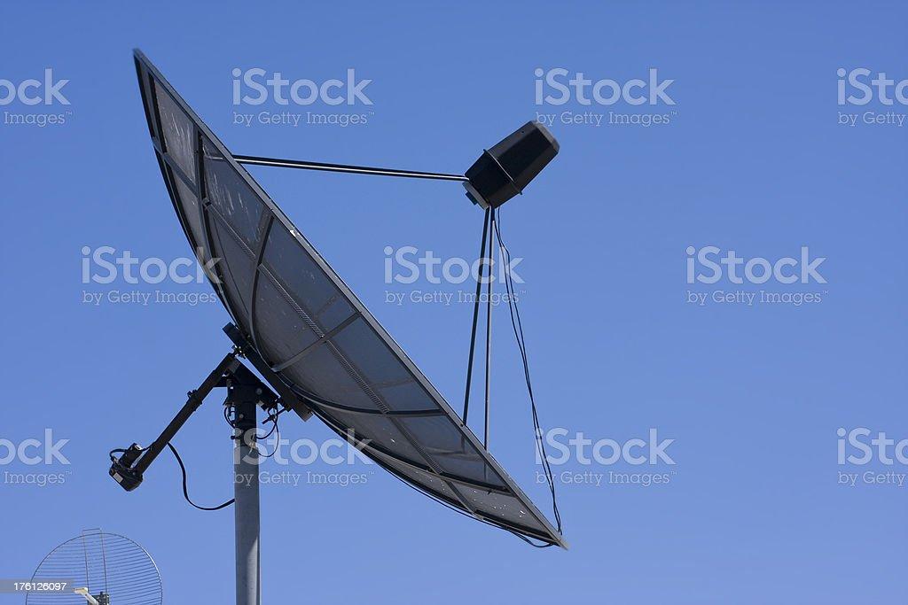 Satellite Dish on Blue Background. stock photo