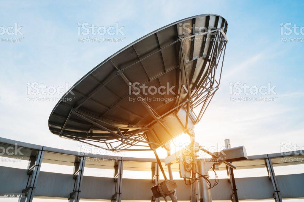 satellite dish on blue sky background stock photo