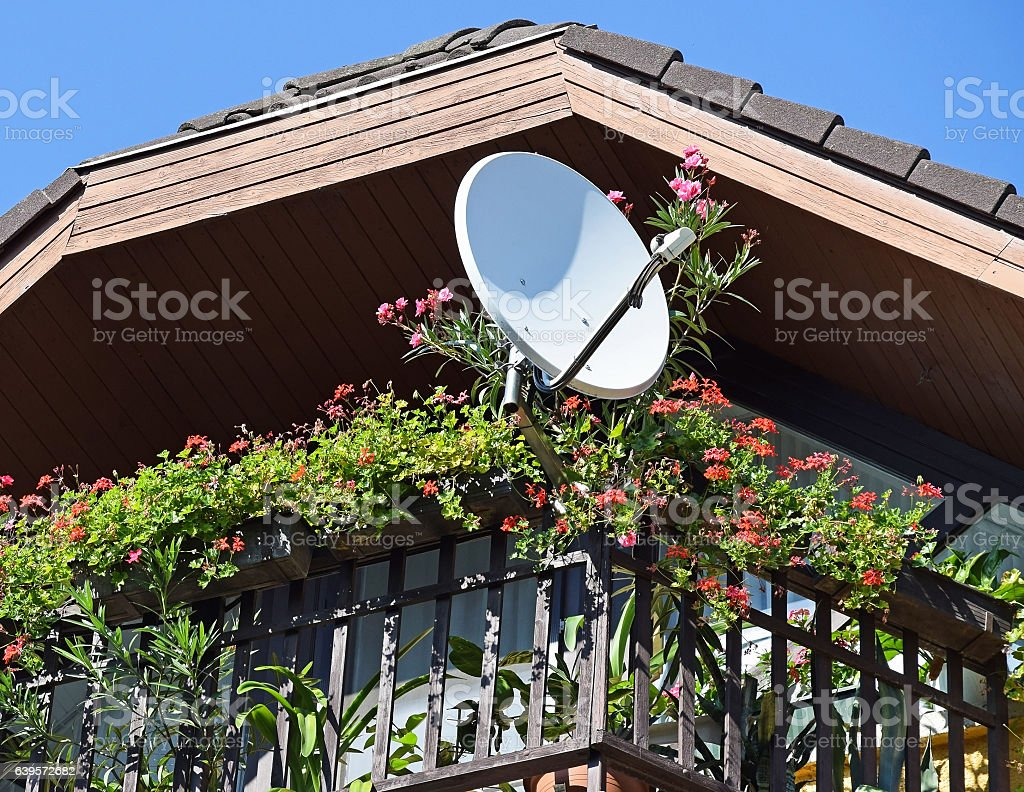 Satellite dish on the balcony stock photo