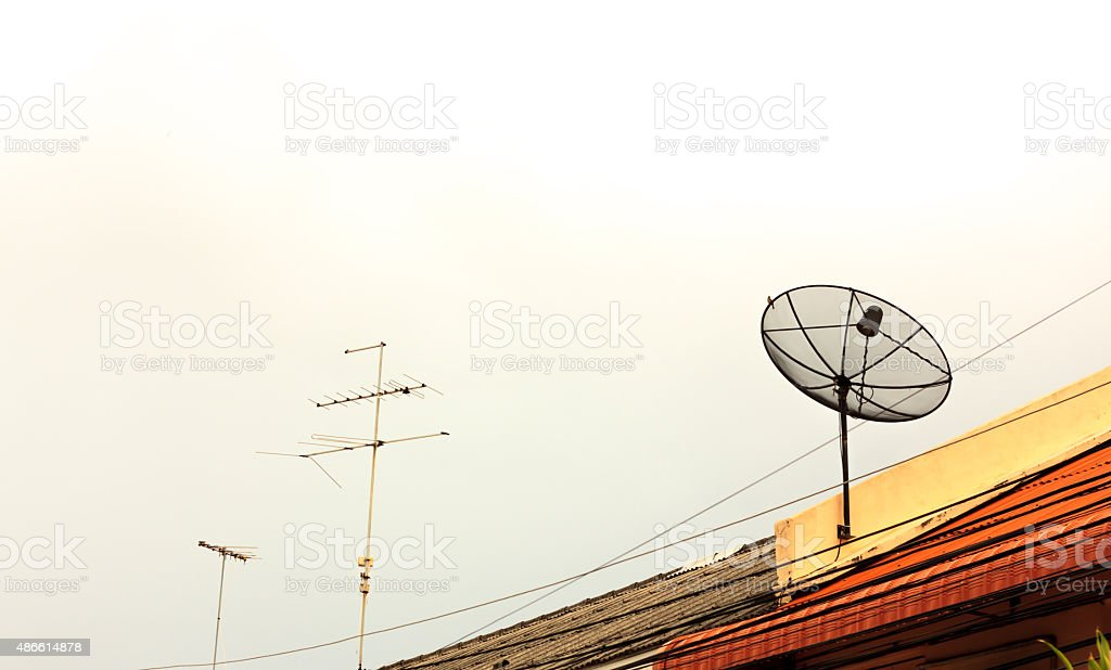 satellite dish on the roof and cloud sky background. stock photo
