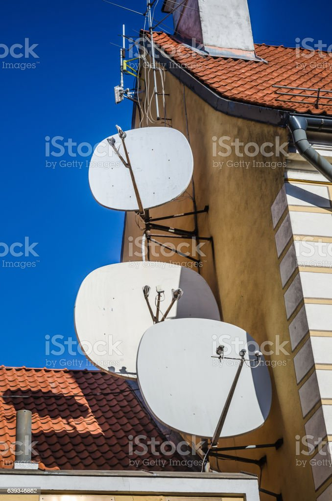 Satellite dish on the roof of an old building stock photo