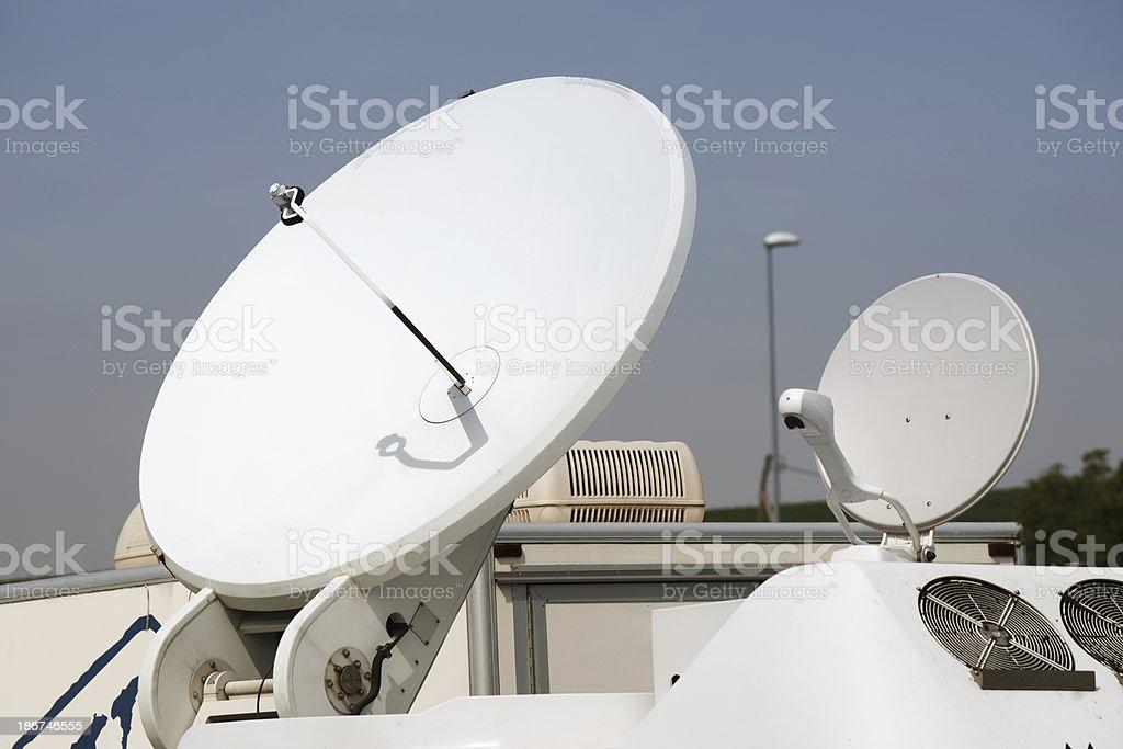 Satellite dish on TV broadcasting vehicle royalty-free stock photo