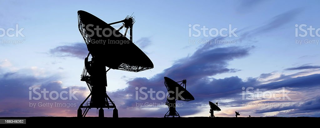 XXXL satellite dish silhouette stock photo