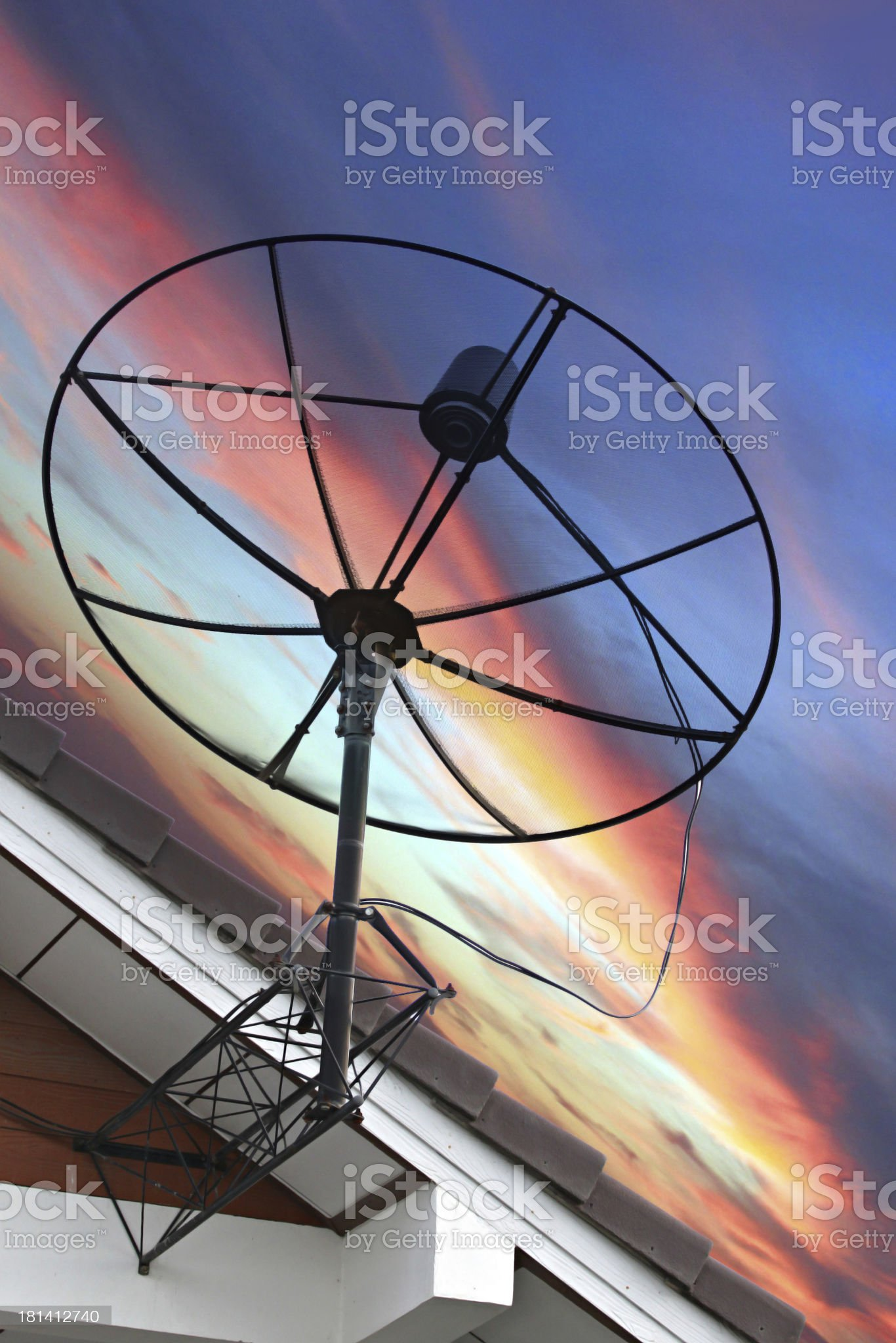 Satellite dish Stuck to roof of house on Evening light. royalty-free stock photo