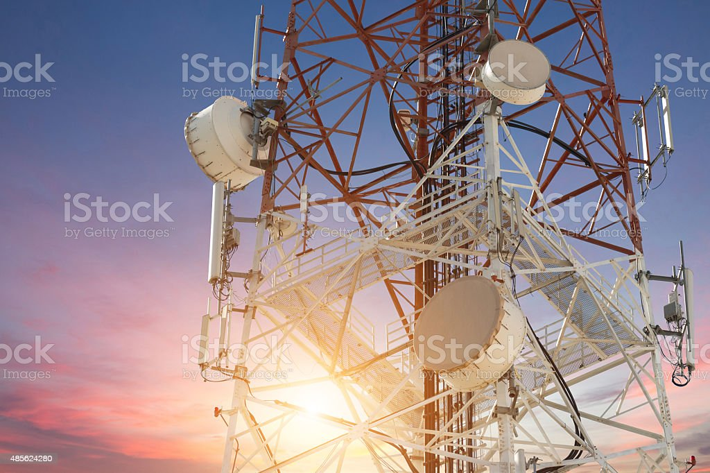 Satellite dish telecom tower at sunset stock photo