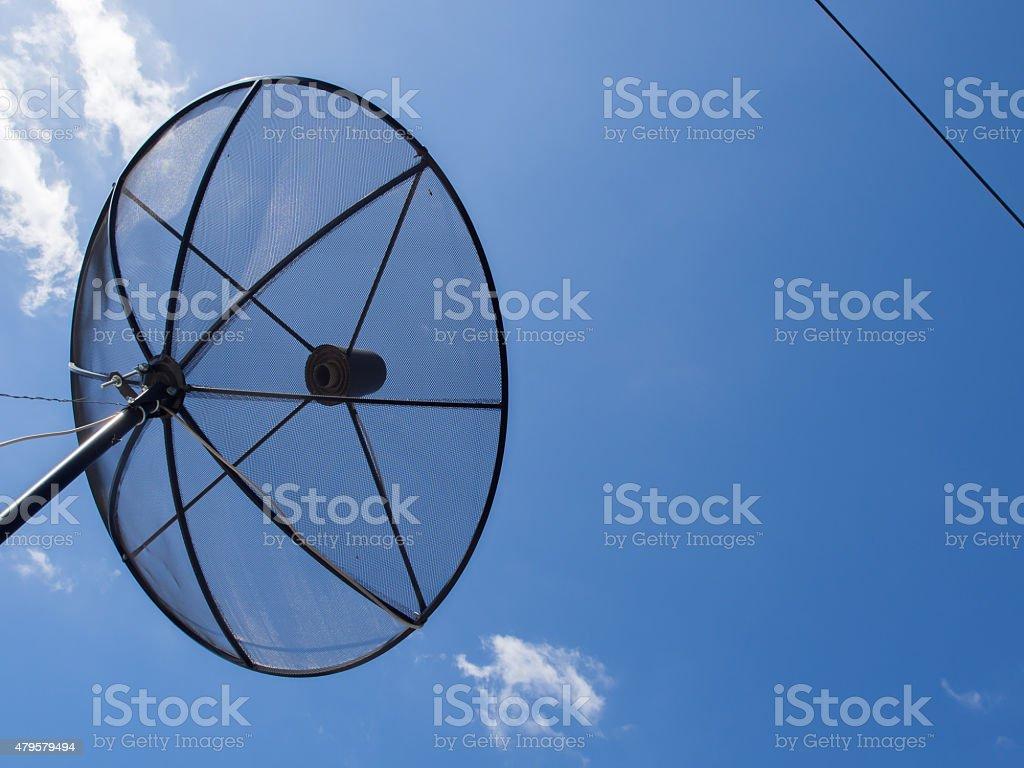 Satellite dish transmission data on blue sky background. stock photo