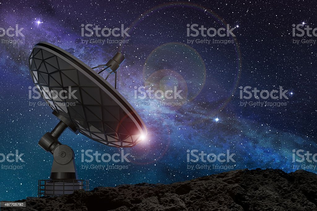 satellite dish under a starry sky stock photo