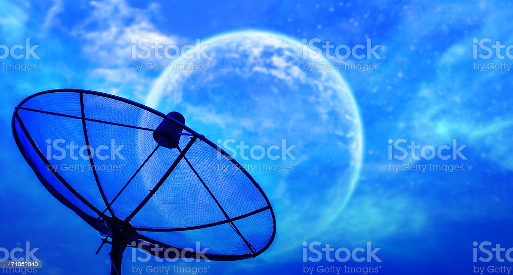 Satellite dish under moon night sky stock photo