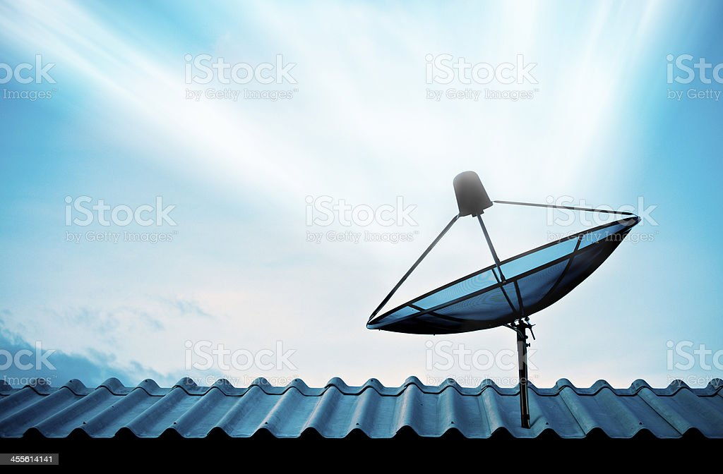 Satellite dish with sky on roof stock photo