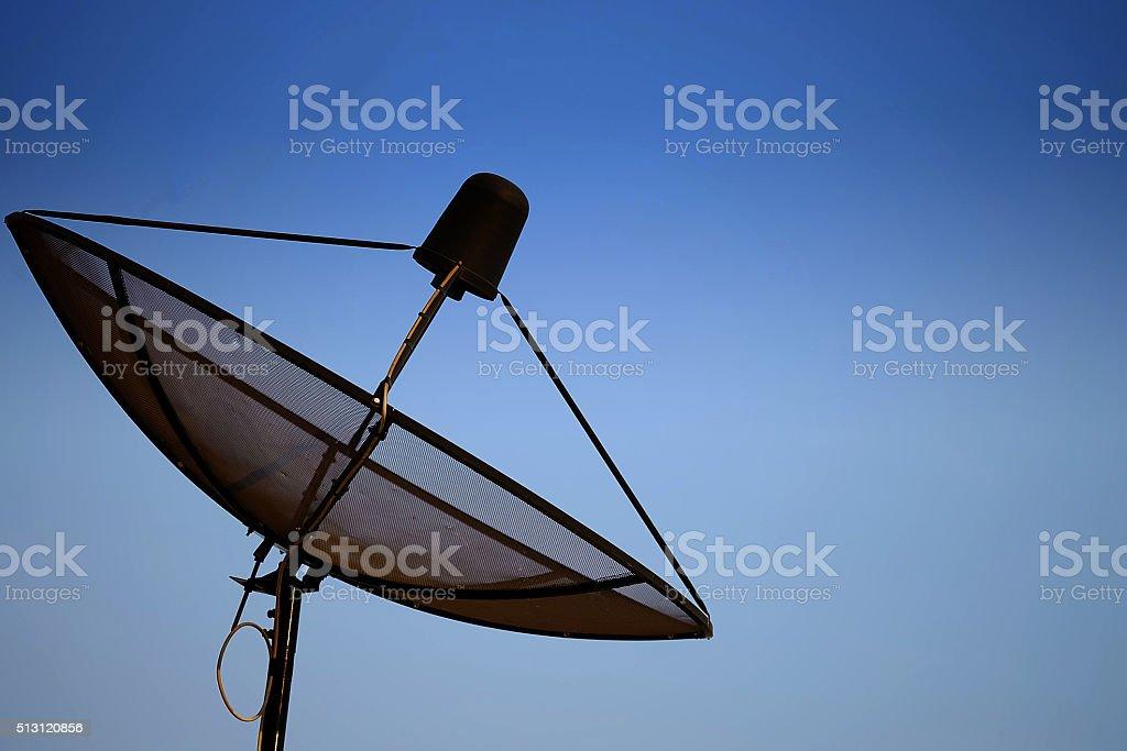 Satellite dish with sky stock photo