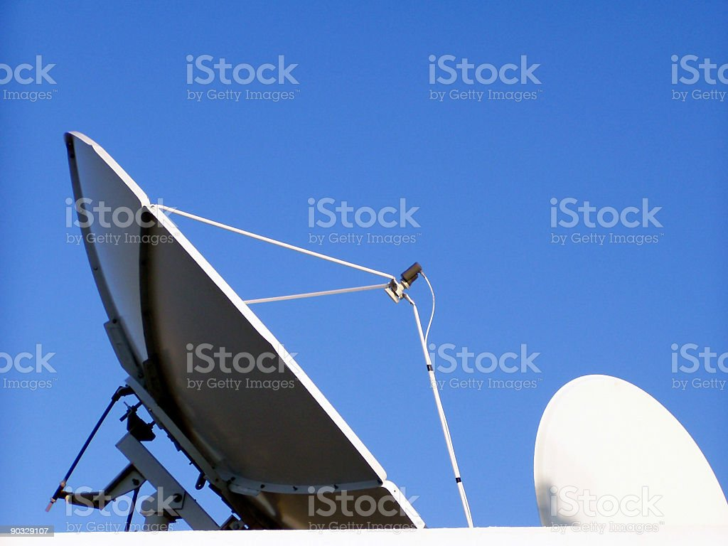 Satellite dishes against blue sky royalty-free stock photo