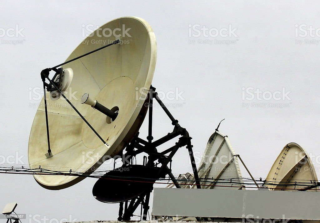 Satellite dishes  at a winter sky background royalty-free stock photo