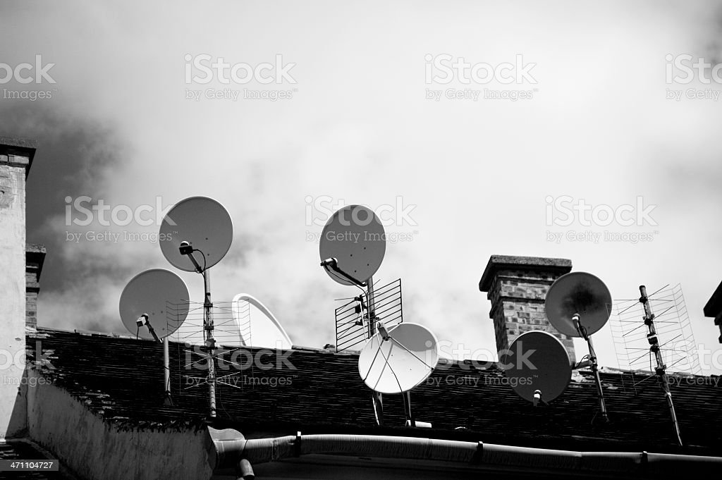 Satellite dishes in black and white royalty-free stock photo