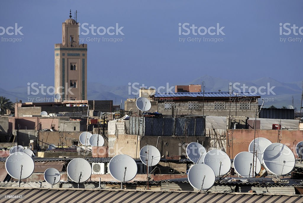 Satellite dishes on roofs stock photo