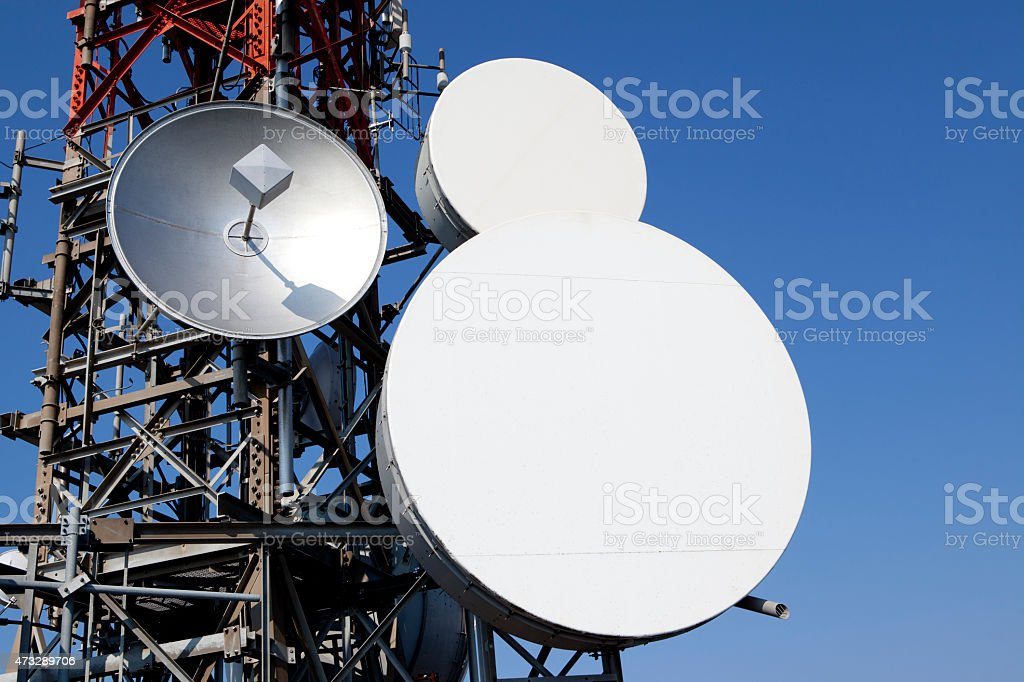 Satellite dishes on telecommunications tower stock photo