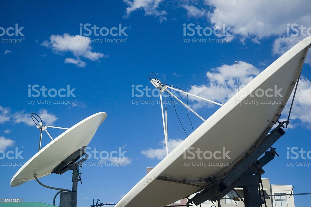 Satellite dishes pointing up to space stock photo