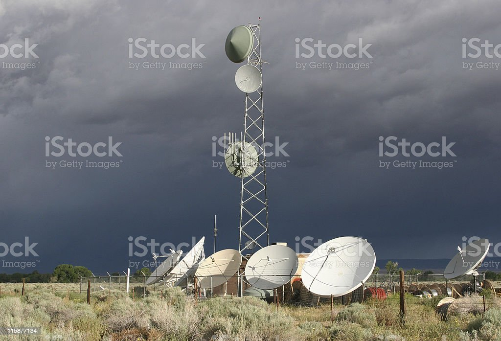 Satellite Dishes Stormy Background royalty-free stock photo