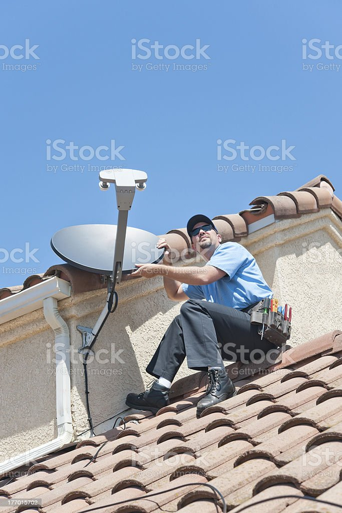 Satellite Installer on Roof 2 stock photo
