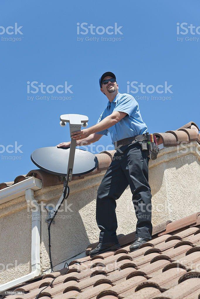 Satellite Installer on Roof stock photo