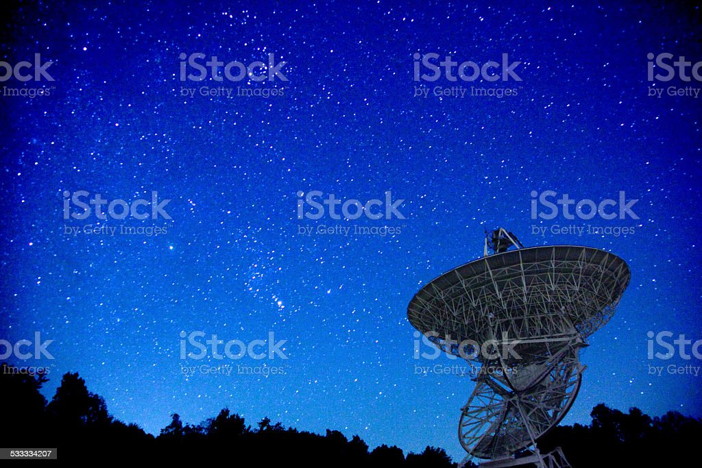 Satellite looking upwards into the night starry sky stock photo