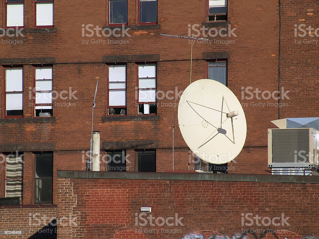 Satellite on brick stock photo