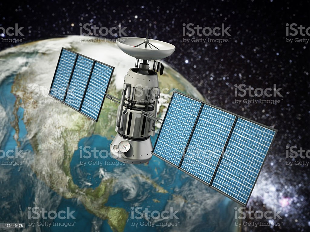 Satellite orbiting the Earth stock photo
