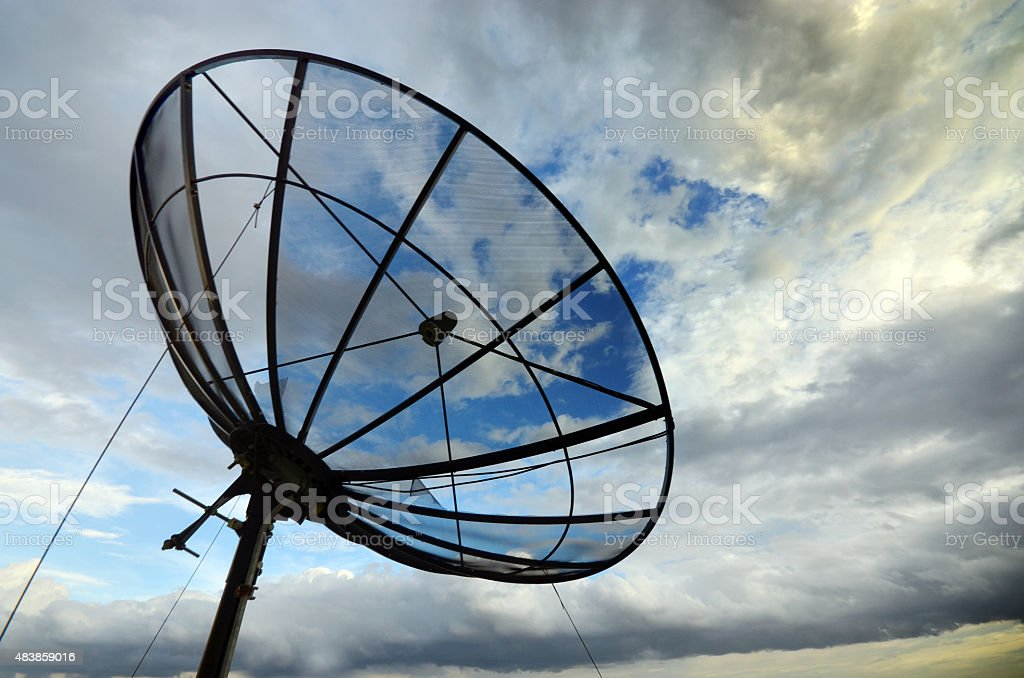 Satellite over cloudy sky stock photo