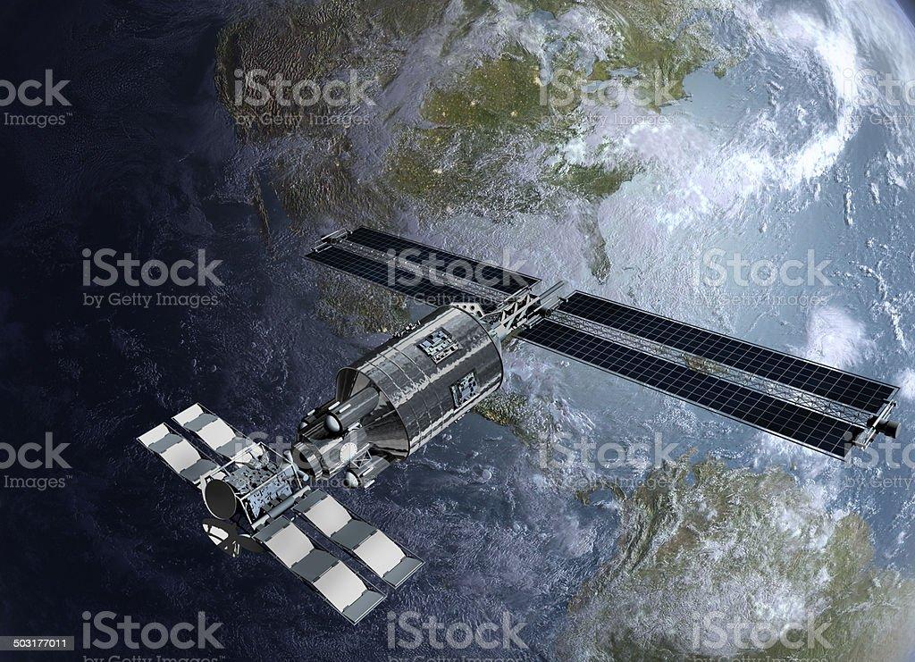 Satellite, spacelab or spacecraft surveilling Earth stock photo