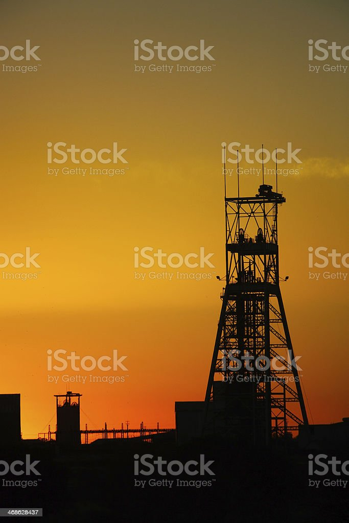 Satellite tower silhouette at sunset stock photo