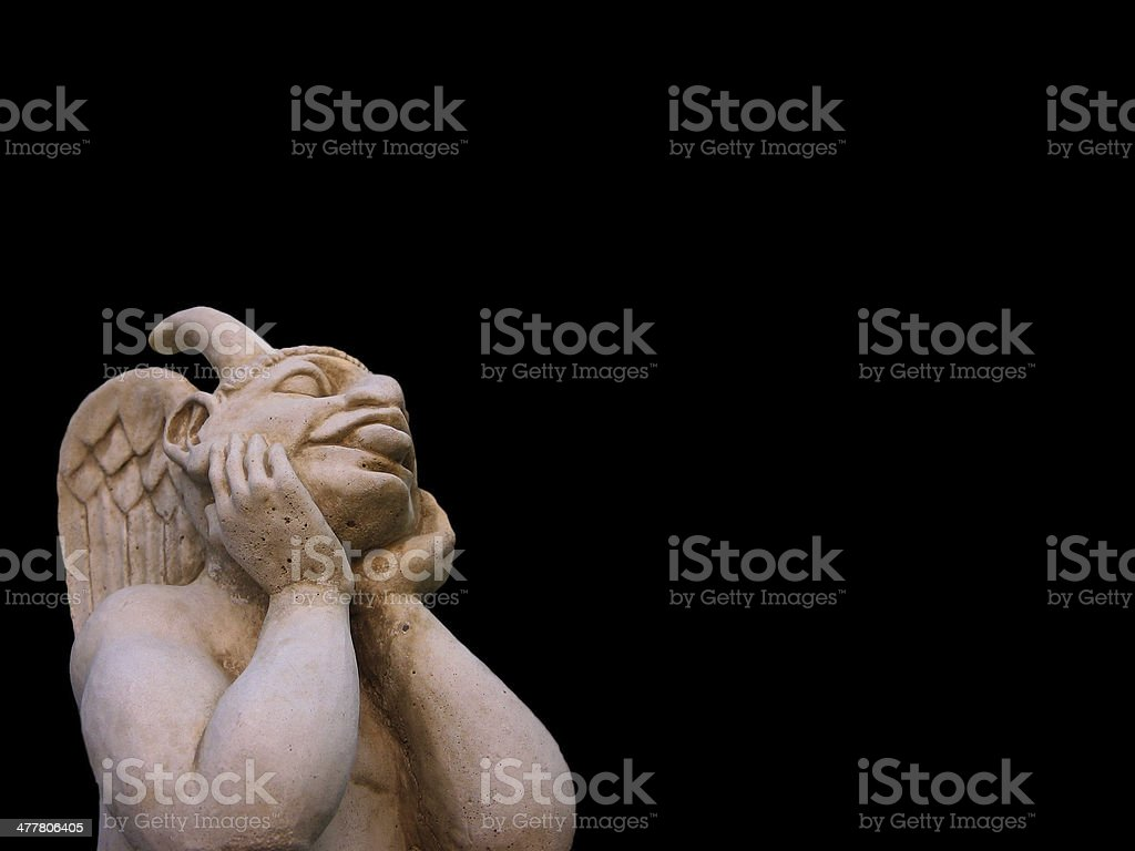 Satirical gargoyle in cut royalty-free stock photo