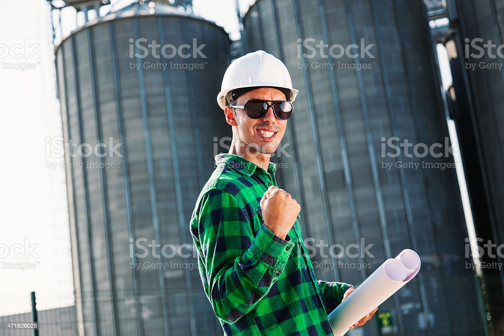 Satisfied construction worker showing positive emotion royalty-free stock photo