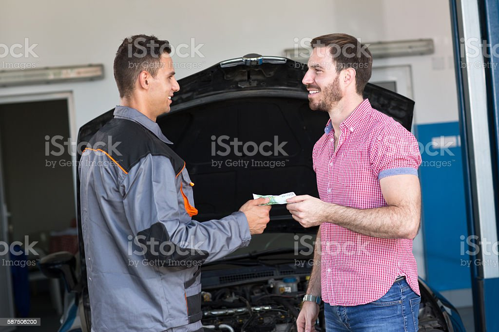 Satisfied customer pays stock photo