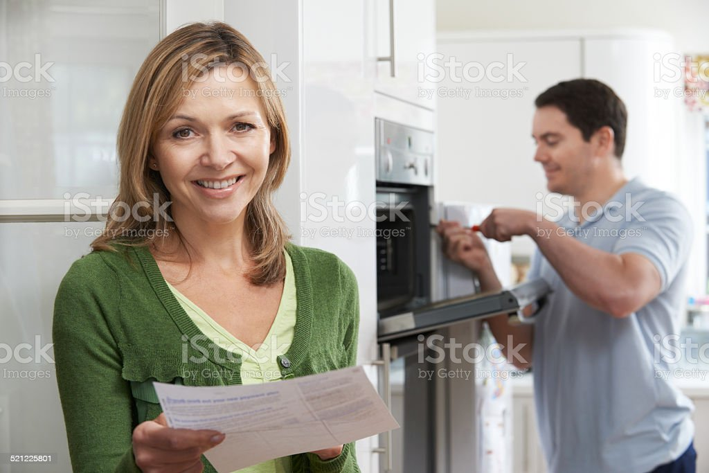Satisfied Female Customer With Oven Repair Bill stock photo