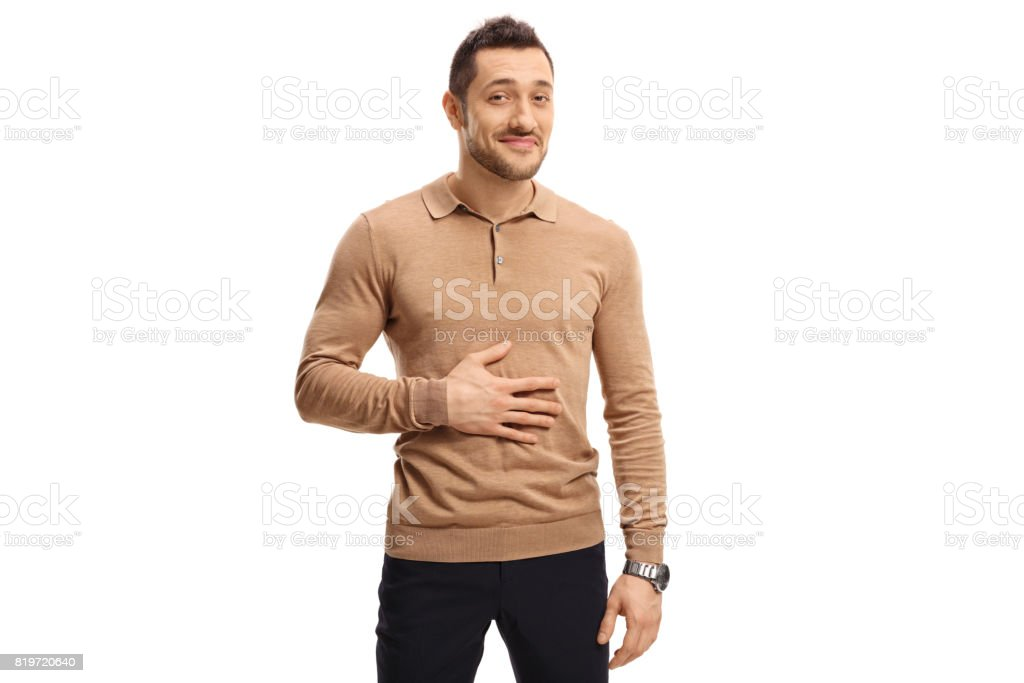 Satisfied man holding his hand on his stomach stock photo