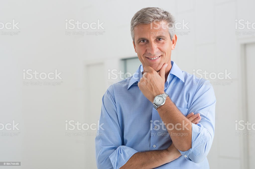 Satisfied Mature Man Idoor stock photo