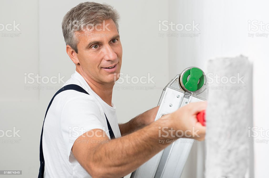 Satisfied Painter Painting Wall stock photo