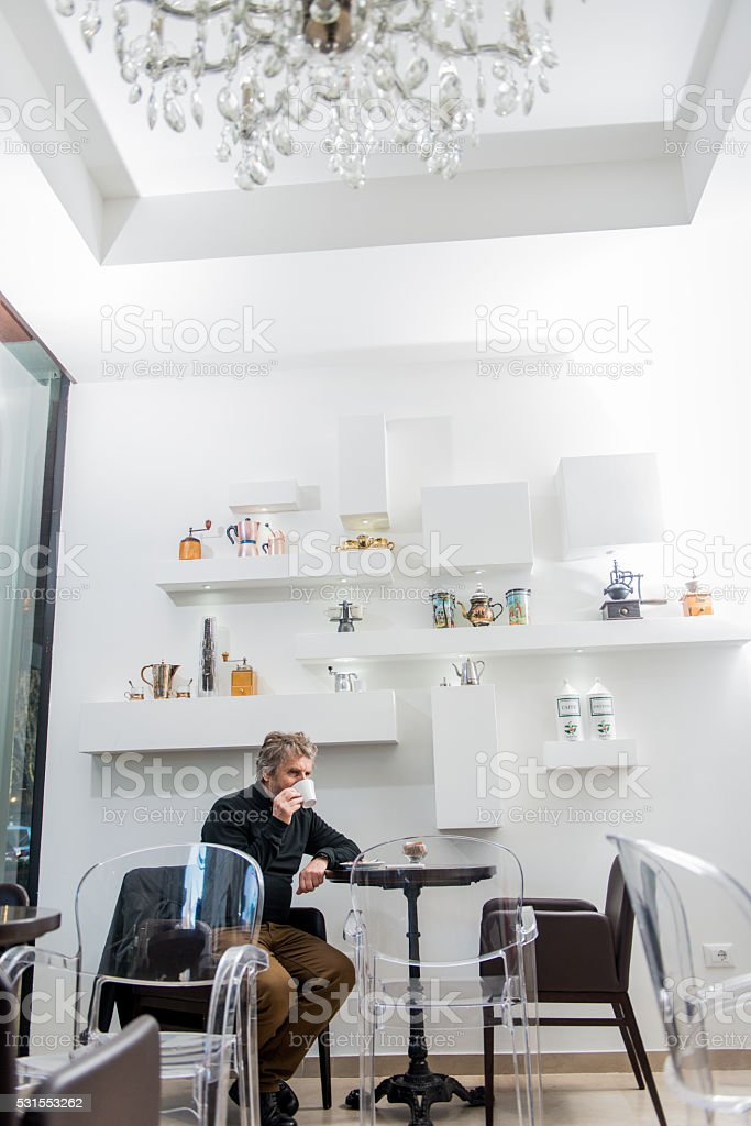 Satisfied Senior Man Having Cappuccino Alone, Caffe Trieste, Europe stock photo