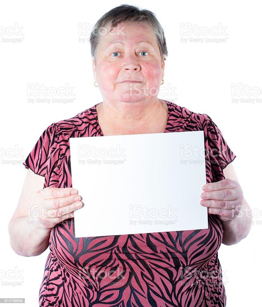 Satisfied senior woman holding blank placard stock photo