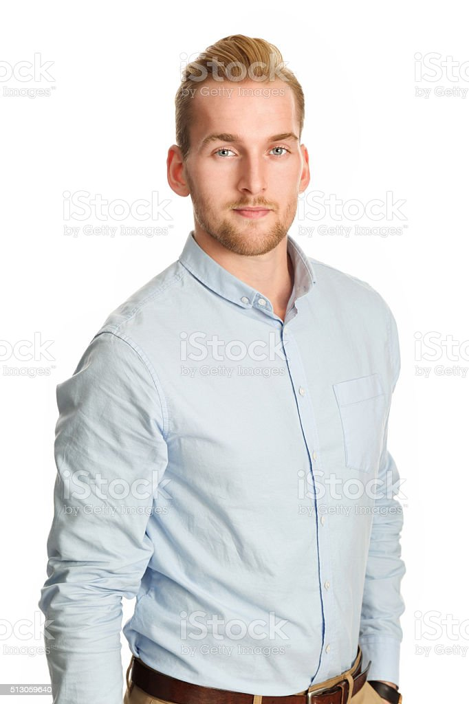 Satisfied young man smiling stock photo