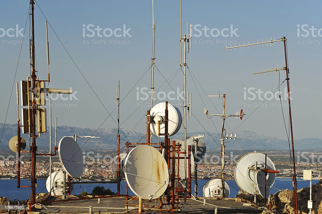 Sattelite mast and dishes at a roof royalty-free stock photo