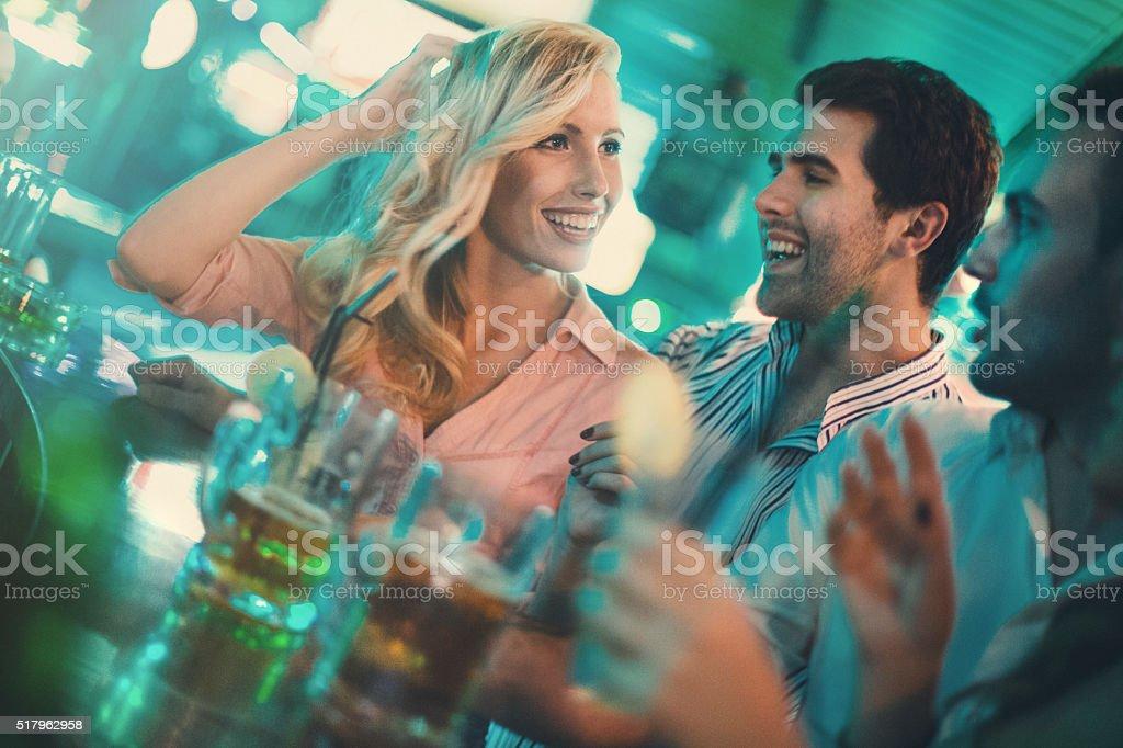 Saturday night fun in a bar. stock photo