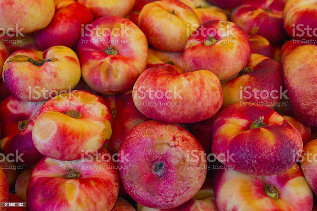 Saturn peaches on  market stall stock photo