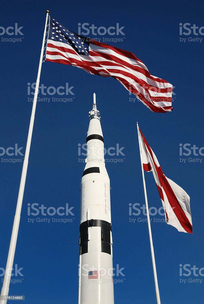 Saturn V Rocket with Flags stock photo