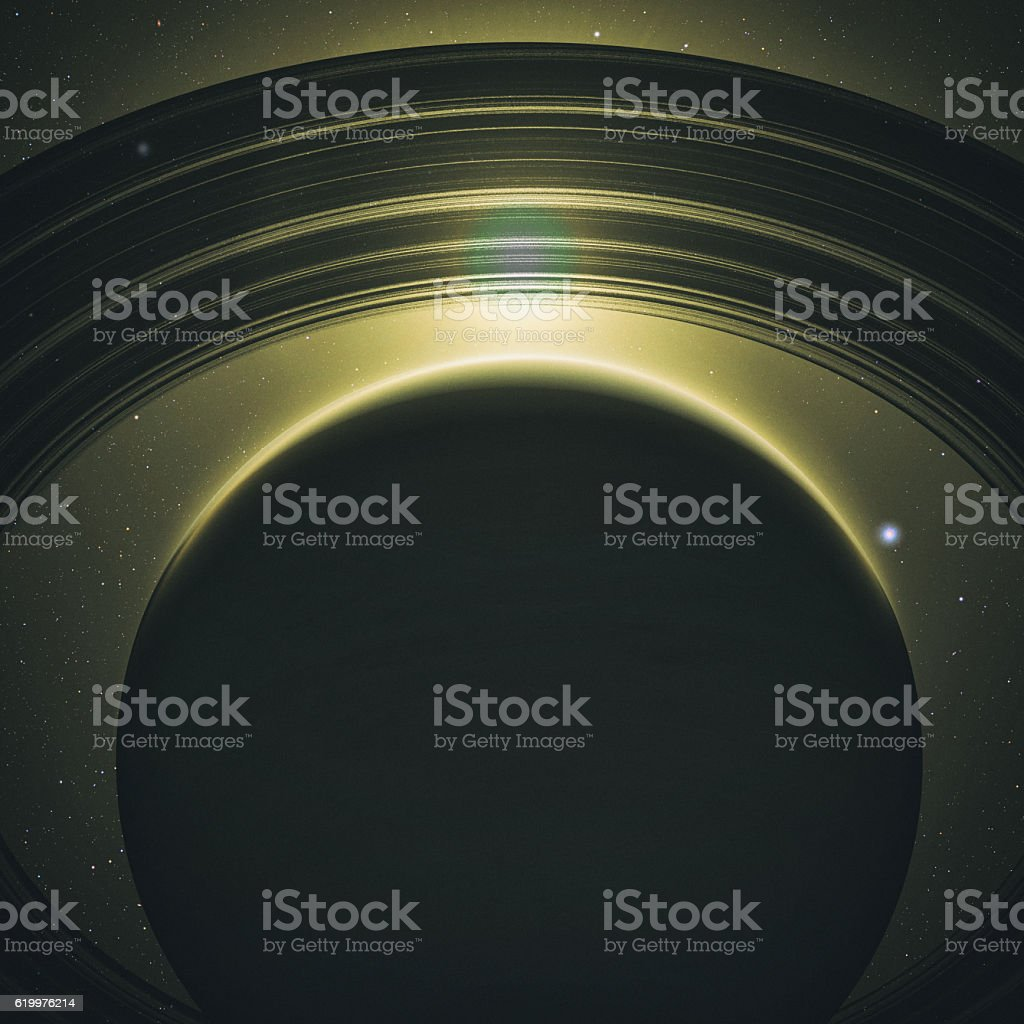 Saturn with rings at sunrise stock photo
