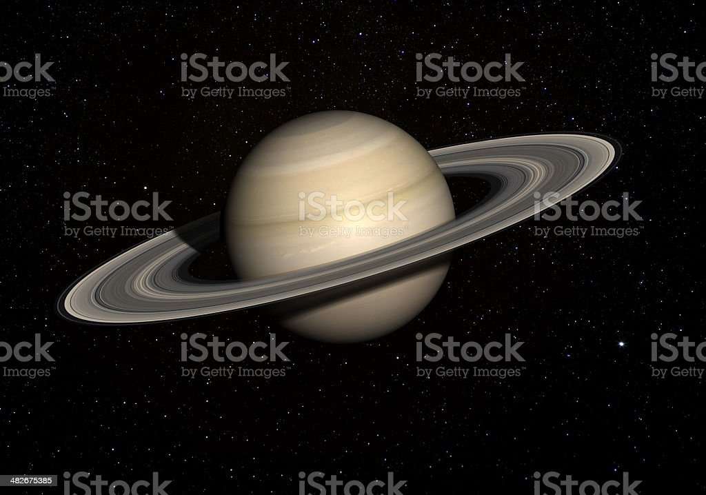 Saturn with stars in the background. stock photo
