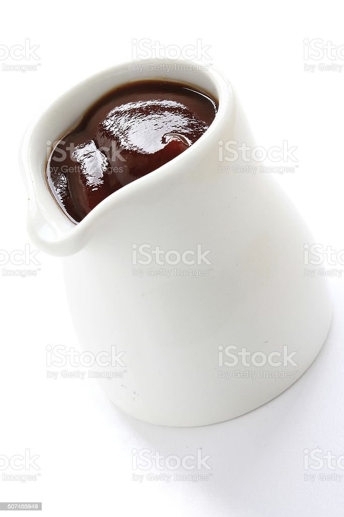 sauce in pouring jug stock photo