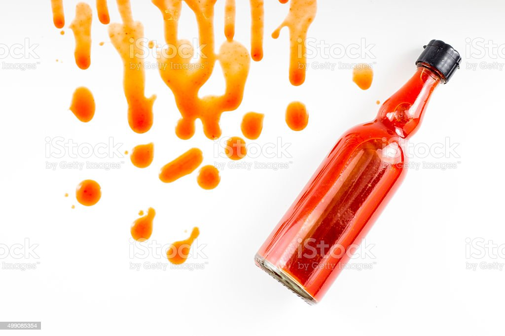 Sauce spilling from bottle stock photo