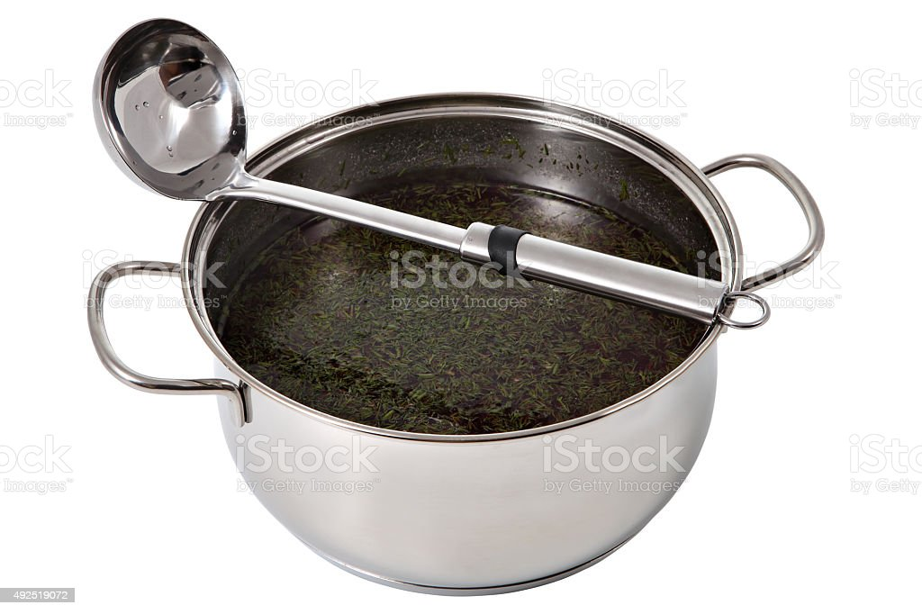 Saucepan with chowder and dipper made of stainless steel. stock photo