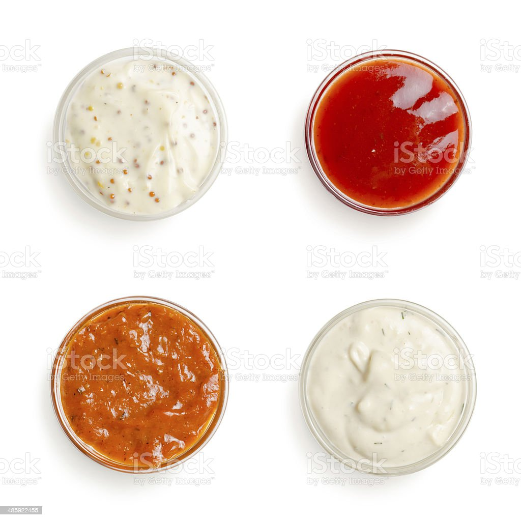 sauces in a gravy boat on white background royalty-free stock photo
